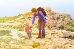 Father and little daughter hiking in mountains Stock Photography