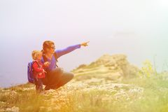Father and little daughter hiking in mountains Royalty Free Stock Image
