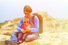 Father and little daughter hiking in mountains Stock Image