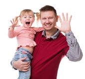 Father with little daughter in his arm showing their palms Royalty Free Stock Photo
