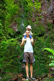Father with little daughter on his shoulders on Wairere Falls T Royalty Free Stock Image