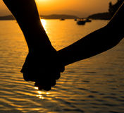 Father and little daughter holding each other hands Stock Photos