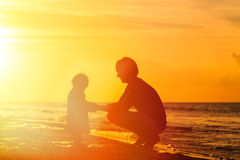 Father and little daughter holding hands at sunset Royalty Free Stock Photos