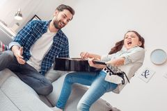 Father and little daughter at home girl making concert for father stock image