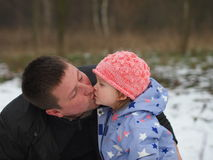 Father and little daughter kissing royalty free stock image