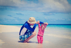Father and little daughter learning to walk on Stock Image