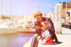 Father and little daughter looking at binoculars Royalty Free Stock Photography