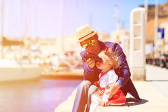 Father and little daughter looking at binoculars Royalty Free Stock Image