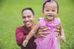 Father with little daughter outdoors. Portrait of Happy young father with little daughter outdoors Stock Photo