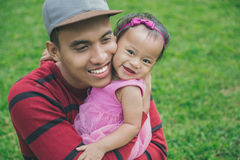 Father with little daughter outdoors Stock Image