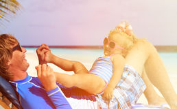 Father and little daughter play on beach Royalty Free Stock Images