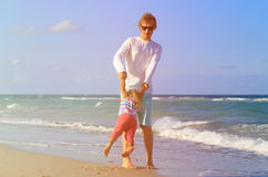 Father and little daughter play at beach Royalty Free Stock Photo