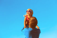 Father and little daughter play at sky Stock Image