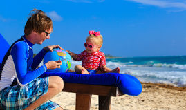 Father and little daughter playing with globe on Royalty Free Stock Photo