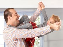 Father and little daughter playing laughing Royalty Free Stock Images
