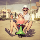 Father and little daughter playing near a house Royalty Free Stock Photography