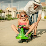 Father and little daughter playing near a house Stock Photography