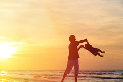 Father and little daughter playing silhouettes  at Royalty Free Stock Photo