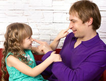 Father and little daughter playing Royalty Free Stock Photography