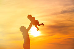 Father and little daughter playing at sunset Stock Photography