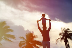 Father and little daughter on shoulders play at sky Stock Photography