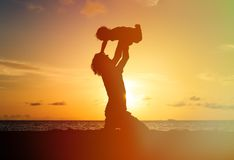 Father and little daughter silhouettes at sunset Stock Photo