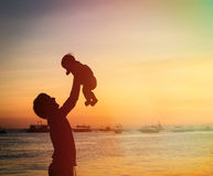 Father and little daughter silhouettes at sunset Stock Image