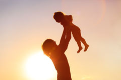 Father and little daughter silhouettes at sunset Royalty Free Stock Image