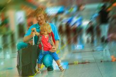 Father and little daughter with suitcase in airport. Family travel stock photos