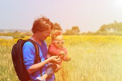 Father and little daughter on summer wheat field Royalty Free Stock Photo