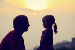 Father and little daughter at sunset sky, family concept Royalty Free Stock Image