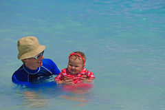 Father and little daughter swimming Stock Photos