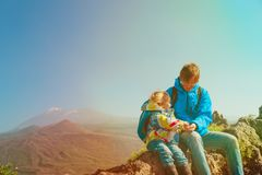 Father and little daughter travel hiking in mountains. Family travel stock photo