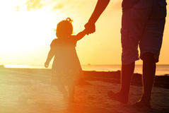 Father and little daughter walking on the beach Royalty Free Stock Photo