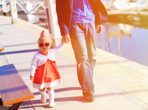 Father and little daughter walking in the port Royalty Free Stock Photos