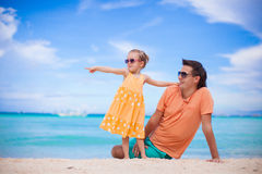 Father and little daughter on white beach Stock Image