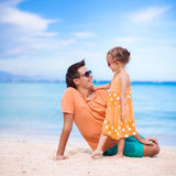 Father and little daughter on white beach Royalty Free Stock Photography