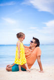 Father and little daughter on white beach Royalty Free Stock Image