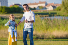 Father and little girl with baggage ready for traveling outdoors Royalty Free Stock Photo