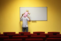 Father and little girl in empty presentation hall Stock Image
