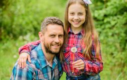 Father little girl enjoy summertime. Dad and daughter blowing dandelion seeds. Keep allergies from ruining your life royalty free stock images
