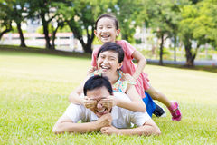 Father and little girl lying on the grass Stock Images