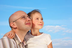 Father and little girl on sky background Royalty Free Stock Photo
