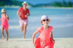 Father and little kids enjoying beach summer tropical vacation. Family playing on the beach Stock Image