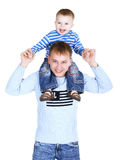 Father with the little son. Young father with the little son on the shoulders isolated on white Stock Image