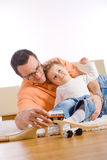 Father and little son. Little boy and father enjoying time together at home in living room Stock Photo