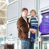 Father and little son at the airport Stock Photos