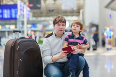 Father and little son at the airport Royalty Free Stock Image