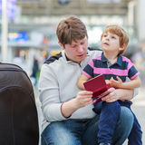 Father and little son at the airport Royalty Free Stock Photography