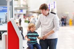 Father and little son at the airport Royalty Free Stock Photo